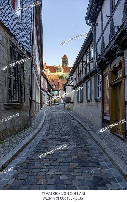 Germany, Saxony-Anhalt, Quedlinburg, Alleyway and St. Servatius church