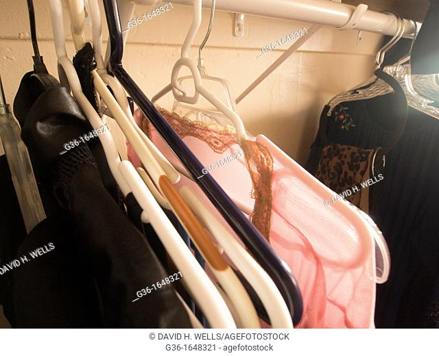 Clothes hanging in a closet in an abandoned house in a foreclosed house in Huntington Park, California, United States