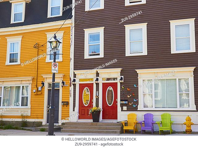 Colourful chairs outside bright coloured typical houses, St John's, Avalon Peninsula, Newfoundland, Canada
