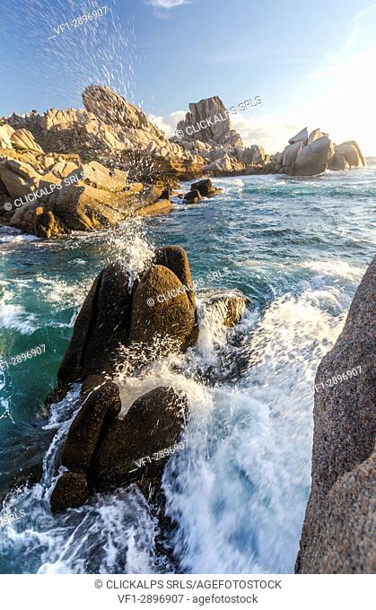Waves crashing on cliffs at sunset Capo Testa Santa Teresa di Gallura Province of Sassari Sardinia Italy Europe
