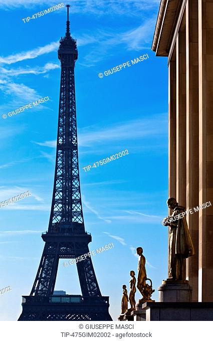 France, Paris, Golden statues at the Palais de Chaillot and the Tour Eiffel