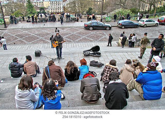 People listenig at street musician in Montmartre, Basilique du Sacre Coeur, Paris, France