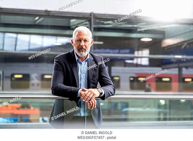 Portrait of mature businessman at the station platform