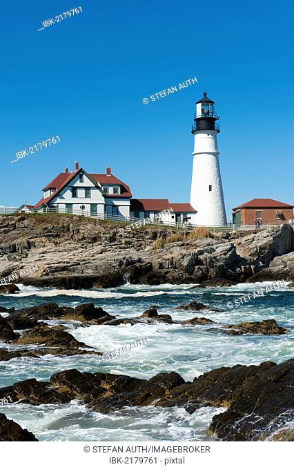 Lighthouse, waves breaking on rocks, Portland Head Light, Cape Elizabeth, Portland, Maine, New England, USA, North America