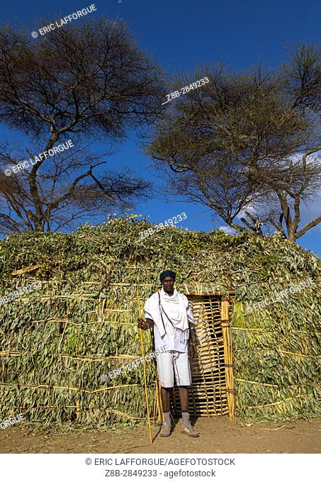 Borana man standing in front of a hut during the Gada system ceremony, Oromia, Yabelo, Ethiopia