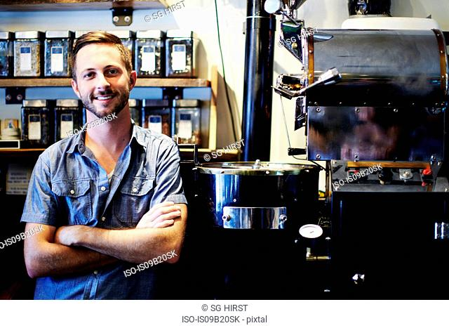 Portrait of young man working in coffee shop