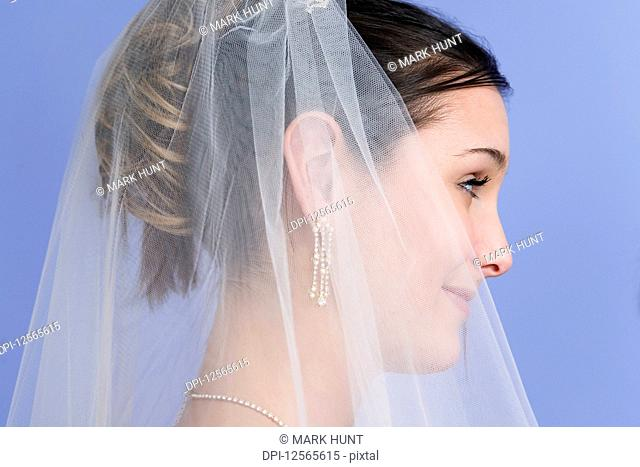 Side view of a young bride smiling