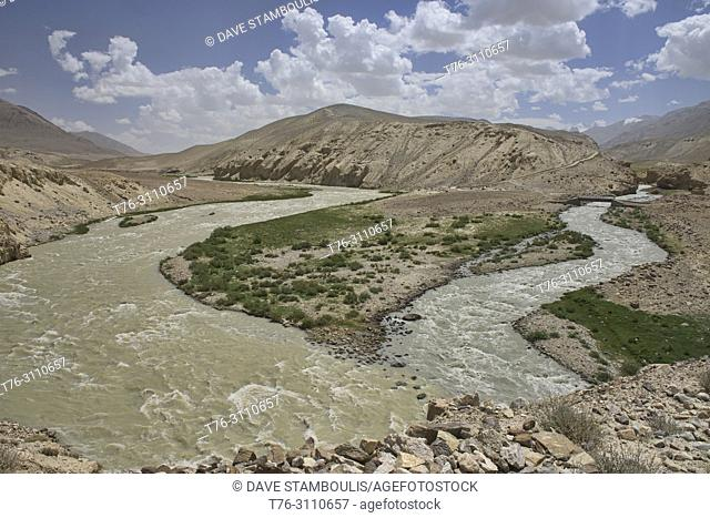 The wild Pamir and then Panj River divides Afghanistan and Tajikistan along the Wakhan Valley, Pamir Highway, Tajikistan