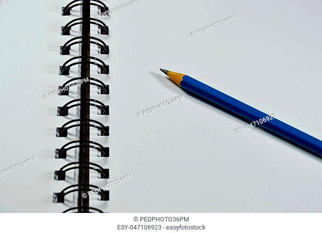 sketchbook binding and blue pencil