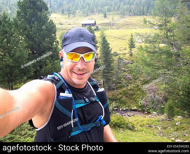 selfie by a runner who has been trailrunning in the carinthian mountains
