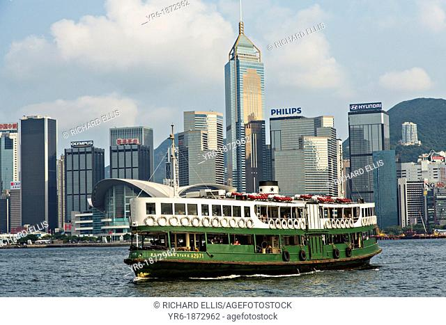 Star Ferry crossing Victoria Harbour with Central District in the background Hong Kong