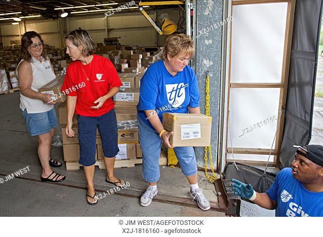 Romulus, Michigan - The nonprofit organization First Book joins with members of the American Federation of Teachers and other volunteers to sort books for...