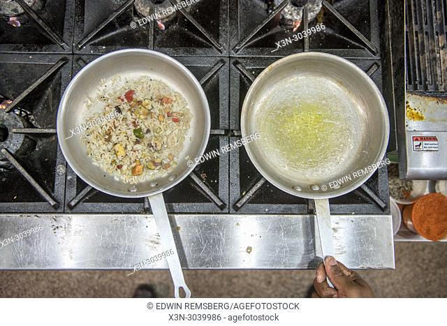 Pans of rice and butter in commercial kitchen