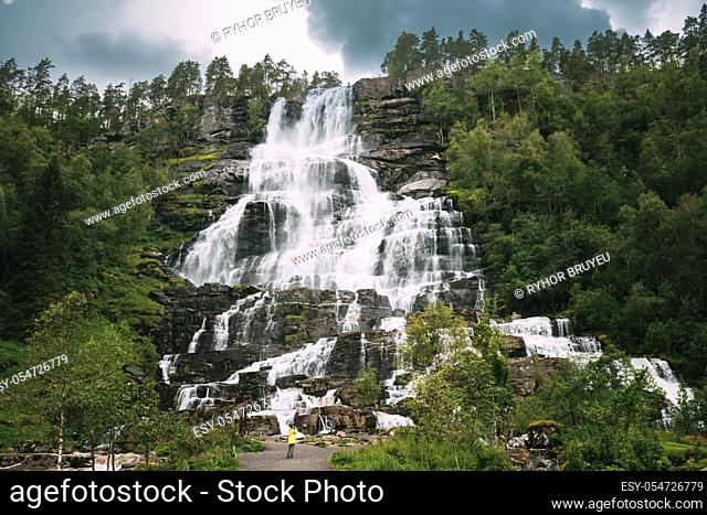 Voss, Hordaland, Norway. Waterfall Tvindefossen In Spring. Largest And Highest Waterfall Of Norway. Famous Natural Norwegian Landmark And Popular Destination