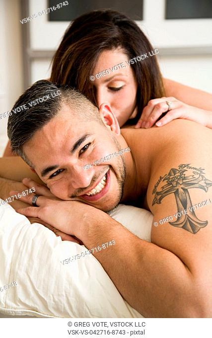 Young woman kissing husband