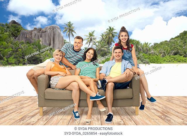 friends sitting on sofa over seychelles island