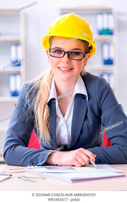 Woman architect working on the project