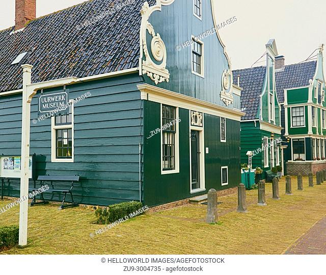 Sign for Dutch Watch and Clock Museum and row of historic wooden buildings, Zaanse Schans, Zaanstad, north Holland, Netherlands