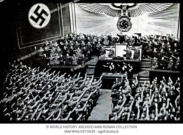 Photograph of a Reichstag Rally from the Kroll Opera House, in Berlin. Hitler addresses the Reichstag putting forward proposal for peace which was denounced by...