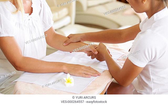 Cropped footage of a professional massage therapist giving a gentle arm massage to a customer