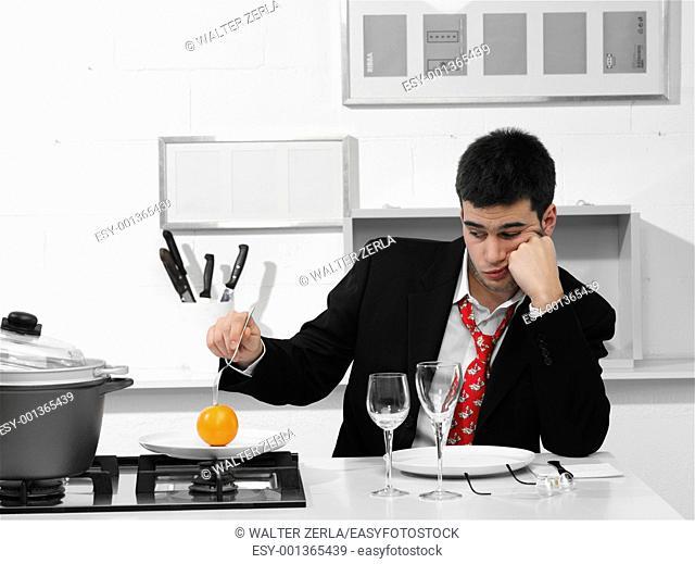 single business man that is preparing dinner