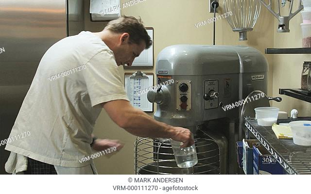 man preparing dough in a commercial kitchen