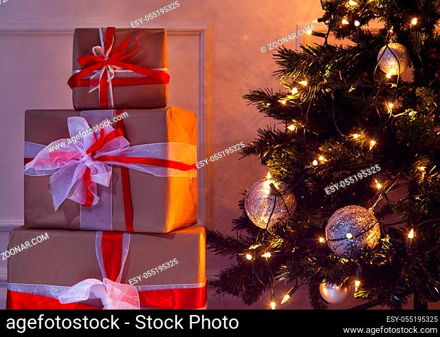 New Year, celebration. Beautiful, shiny Christmas tree with gifts