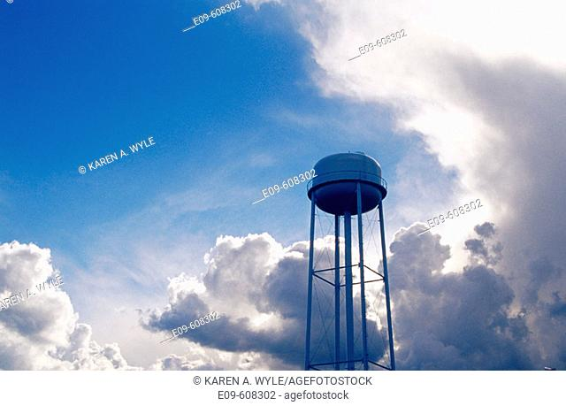 Water tower against blue sky being invaded by storm clouds, South Central Indiana