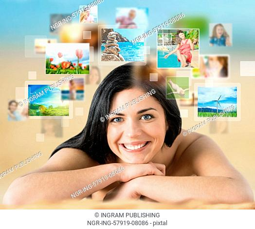 Woman laying on beach with lots of pictures around her. Cloud storage service, online sharing concept