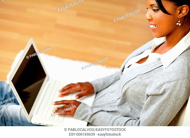 Top view portrait of an attractive woman working on laptop at home indoor