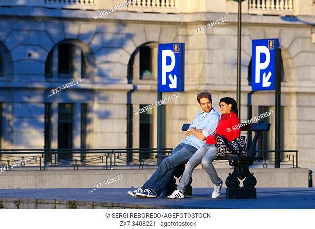 Parking, a couple in Poelaert square, Marolles neighborhood, Brussels, Belgium