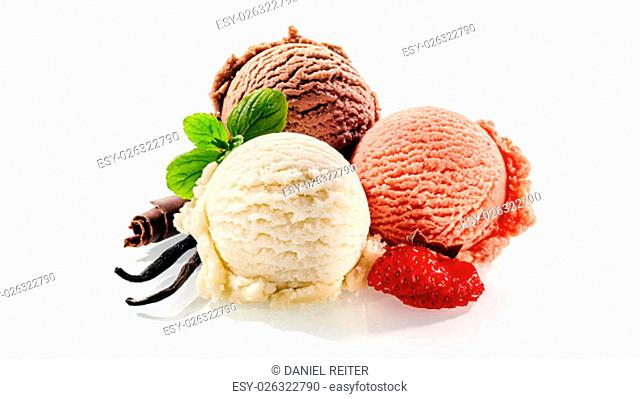 Three single scoops of strawberry vanilla and chocolate dessert decorated with cut fruit and mint leaves on a white background