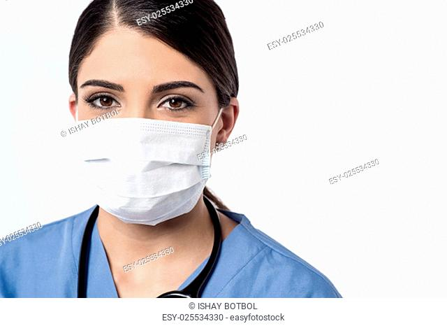 Female surgeon posing with surgical mask