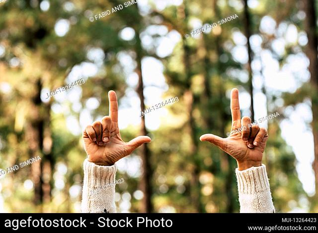 Nature and save forest trees world with hands of woman nad green background wood - your text here and copy space concept environement image - no deforestation...