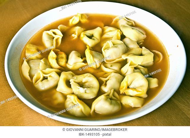 Tortellini pasta with broth, traditional recipe from Emilia Romagna, Italy