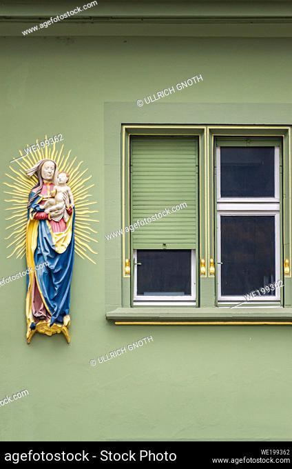 Madonna sculpture on a historic house facade, Freiburg im Breisgau, Baden-Wurttemberg, Germany