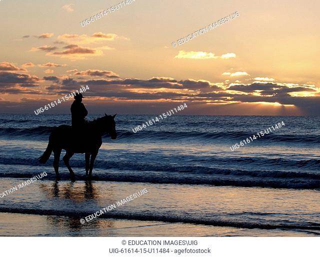 Horse rider at the beach, Bude, Cornwall