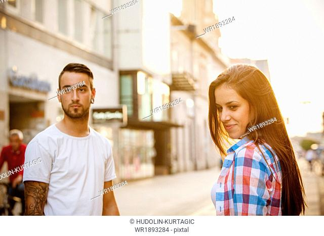 Portrait of young couple on city street