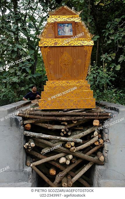 Ban Xieng Maen, village near Luang Prabang, Laos: coffin ready to be burnt on a pyre during a Buddhist funeral