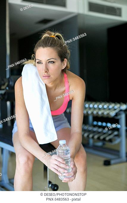 Woman taking a break in fitness center