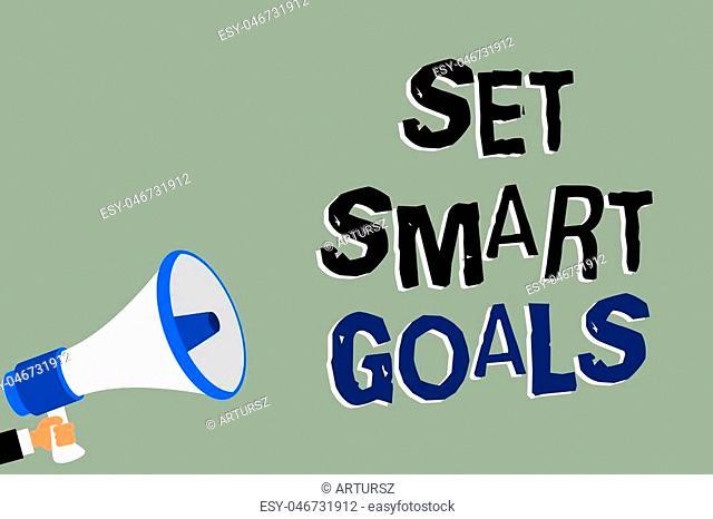 Writing note showing Set Smart Goals. Business photo showcasing Establish achievable objectives Make good business plans Man holding megaphone loudspeaker green...