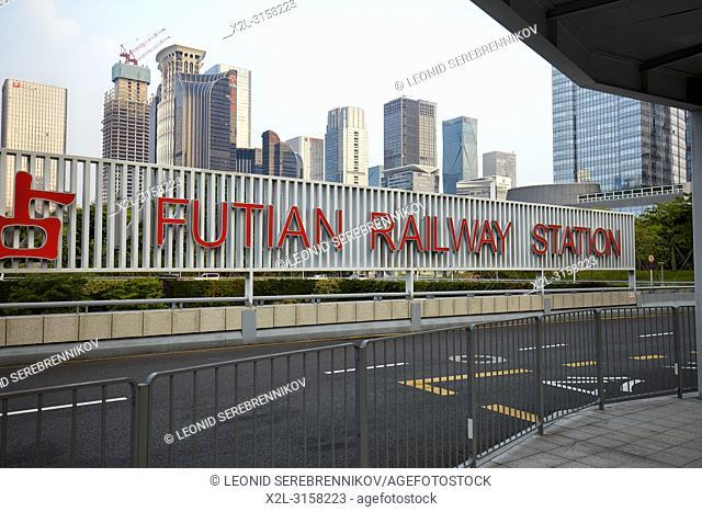 Futian railway station and high-rise buildings of Futian CBD. Shenzhen, Guangdong Province, China