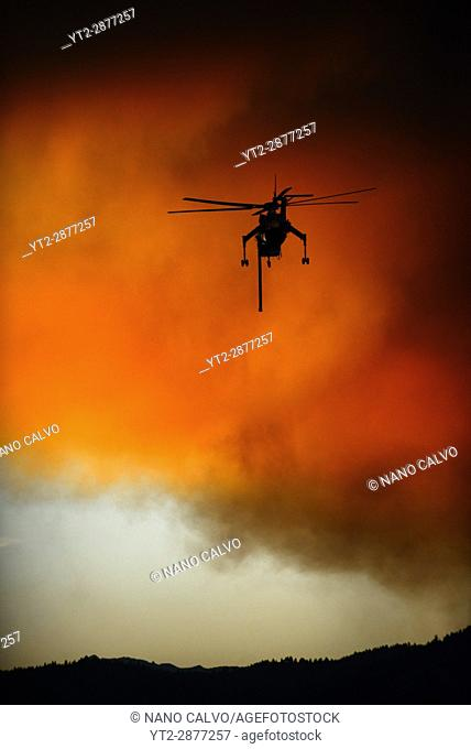 Helicopter fighting wildfire in Yosemite area, California, United States