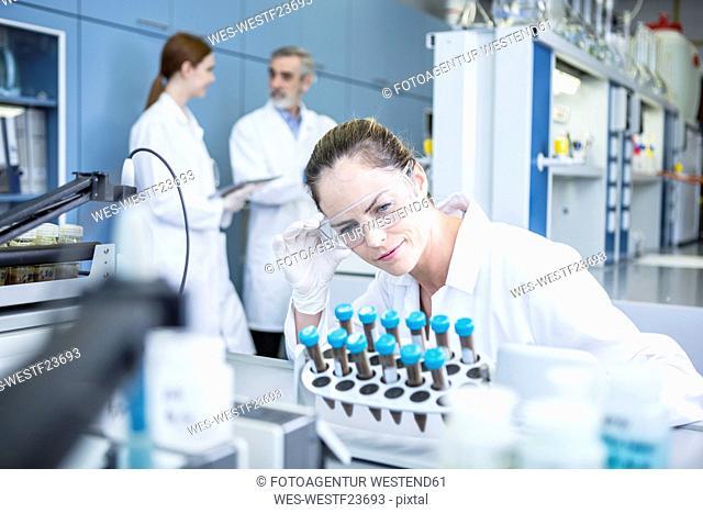 Scientist in lab examining samples