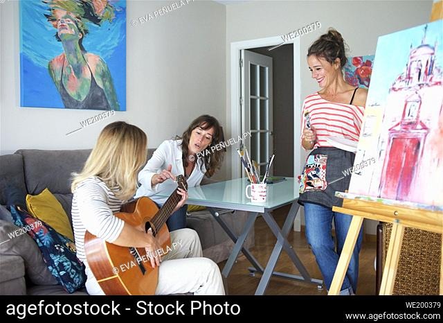 Friends meeting with artistic hobbies