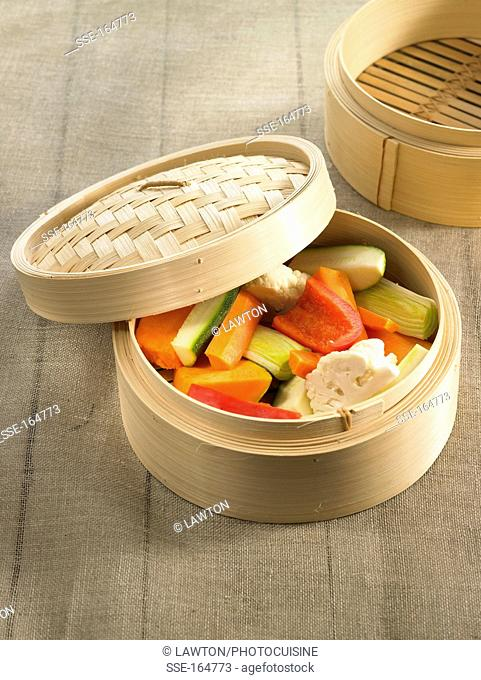 Raw vegetables in a bamboo steam basket