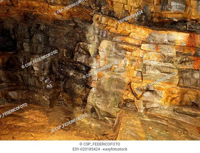visible rock layers with ancient sediments in the mine of minerals and fossils
