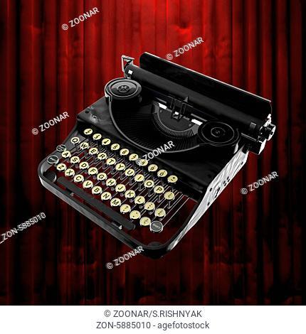 retro typewriter and red curtain