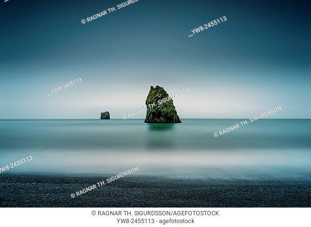 Basalt sea stacks in the ocean, Dyrholaey, Iceland