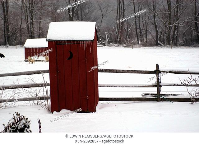 Red outhouse covered with a fresh layer of snow Fallston Maryland USA